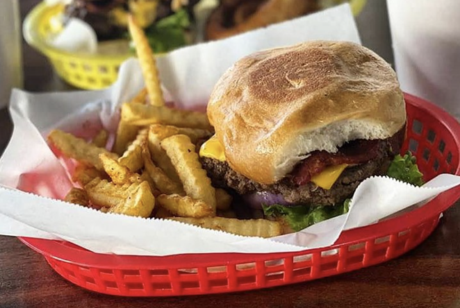 Local burger joint Mark's Outing is offering a bacon cheeseburger on a homemade honey bun for Black Restaurant Week San Antonio 2021. - INSTAGRAM / MARKSOUTING