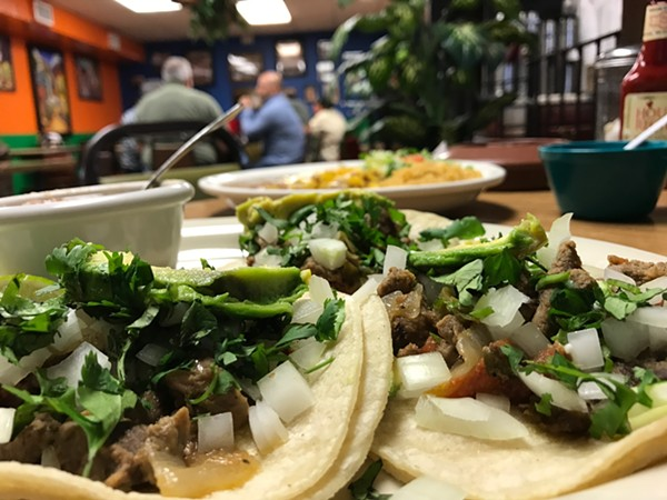 A view of the street tacos and the dining room at Little Taco Factory.