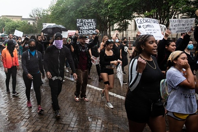 Black Lives Matter protesters march in downtown San Antonio last June. - JAIME MONZON