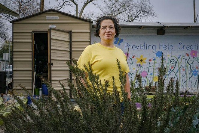 Jennifer Sierra tends to the St. Phocas Garden, growing an assortment of vegetables and herbs year-round to supplement a local food pantry — the only source of fresh produce for some of its clients. - CHRISTOPHER LEE / TEXAS TRIBUNE