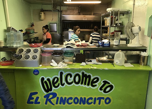 You pass the kitchen on the way to the dining area at El Rinconcito. - BEN OLIVO