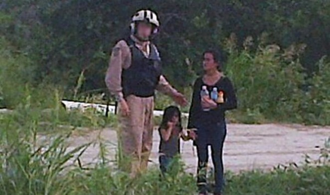 This 2014 photo shows a dehydrated teenage girl accompanied by a little girl who Border Patrol rescued in the Rio Grande Valley. Both were likely turned over to Immigration and Customs Enforcement. - U.S. BORDER PATROL