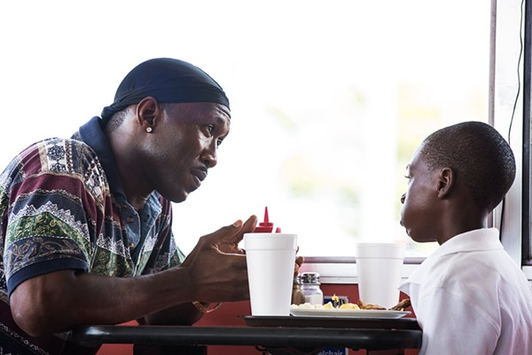 MOONLIGHT CO-STARS MAHERSHALA ALI AND ALEX HIBBERT PHOTOGRAPHED BY DAVID BORNFRIEND, COURTESY OF A24