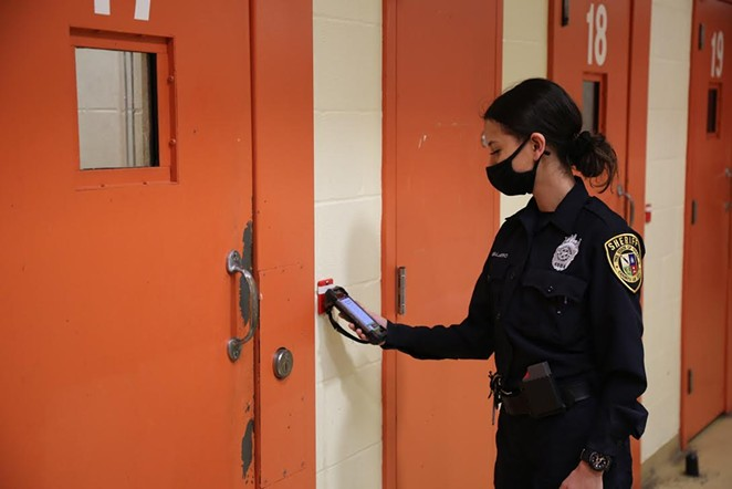 A deputy at the Bexar County Jail checks in on inmates using a new digital system meant to improve accountability. - COURTESY OF BEXAR COUNTY SHERIFF'S OFFICE