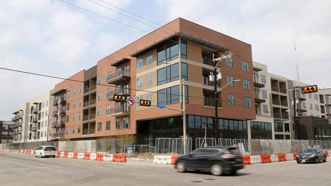 The Flats at River North is nearing completion at the corner of Broadway and Jones Avenue. - BEN OLIVO / SA HERON