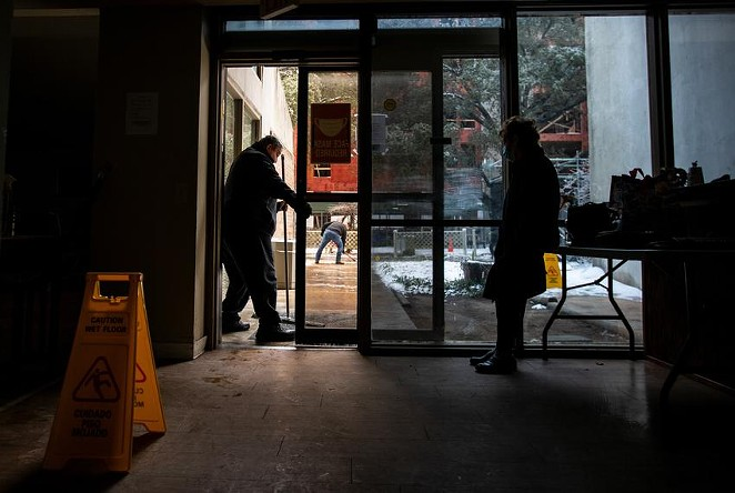 Carmen Pena, right, waited for a ride Feb. 17 at the Rebekah Baines Johnson Center, an independent living center in Austin that lost power during the storm. - MONTINIQUE MONROE / THE TEXAS TRIBUNE