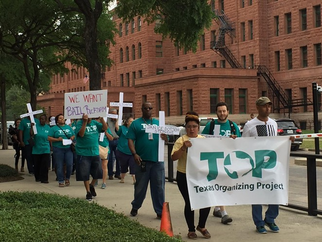 Texas Organizing Project members march in front of the Bexar County Courthouse during 2019 protest for bail reform. - TIFFANY HOGUE