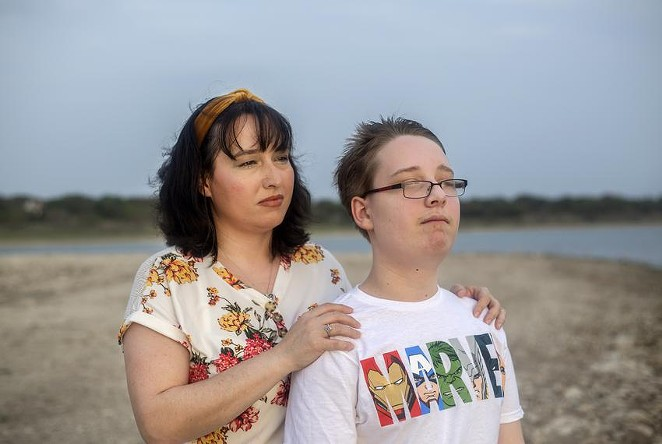Trish and her 12-year-old son look out into the sunset at Canyon Lake on April 13, 2021. Trish earns too much to qualify for Medicaid in Texas but too little to afford her own health insurance. Her son does qualify for Medicaid. - MONTINIQUE MONROE / THE TEXAS TRIBUNE