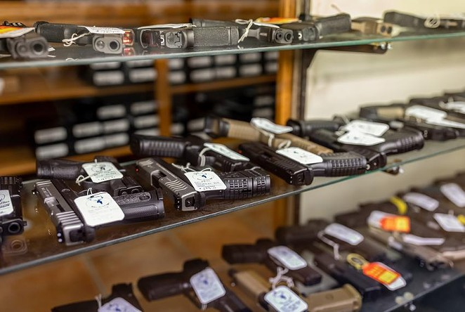 Hundreds of handguns and rifles for sale at McBride's Gun's in Central Austin on April 20, 2021. - JORDAN VONDERHAAR / THE TEXAS TRIBUNE
