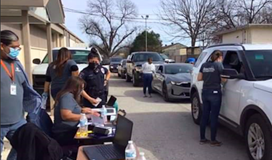 Workers administer Pfizer vaccines at a recent Metro Health mobile clinic. - COURTESY PHOTO / METRO HEALTH
