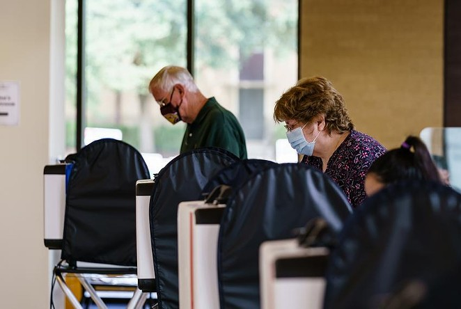 Voters cast their ballots at the Performing Arts Center at Texas State University in San Marcos. - TEXAS TRIBUNE / JORDAN VONDERHAAR
