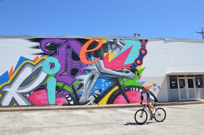 Local duo Los Otros celebrates the cycling community in the Pabst-sponsored mural Ride. - BRYAN RINDFUSS