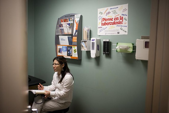 Sonia Wood, a certified pediatric nurse practitioner, treats a patient at Carousel Pediatrics in Austin. Three million children are currently on Medicaid, but most of their parents do not qualify.