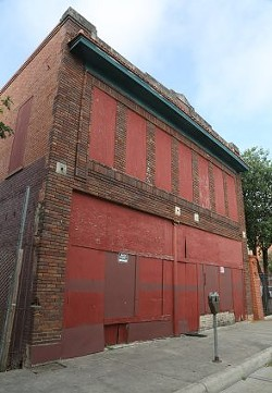 This two-story building at 908 W. Houston St. was built in 1909. - SA HERON / BEN OLIVO