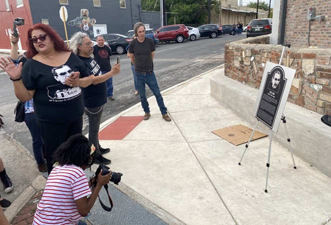 Bell Solloa (left) and Jeff Smith (right) show off a replica of the metal plaque that will hang at Velvet Taco. - SANFORD NOWLIN
