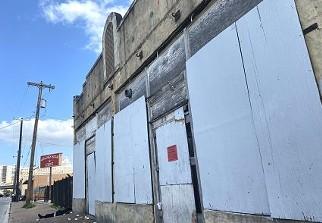 The Whitt Printing Co. building facing West Houston Street. - SA HERON / BEN OLIVO