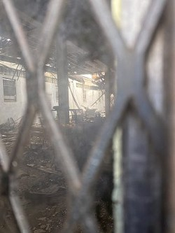 A view of the inside of the Whitt Printing Co. building shows a caved-in roof. - SA HERON / BEN OLIVO
