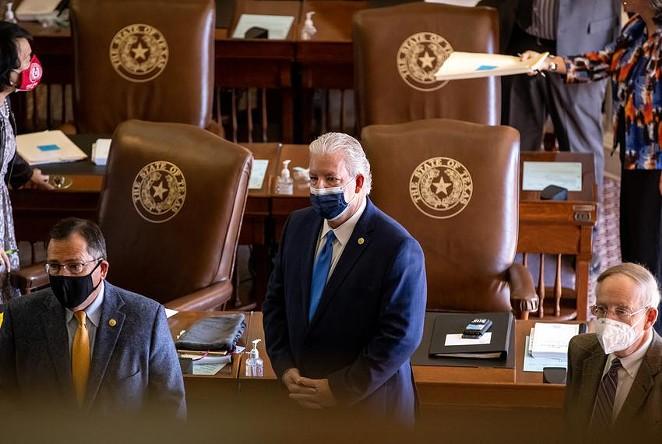 State representatives on the House floor on March 2. - TEXAS TRIBUNE / JORDAN VONDERHAAR