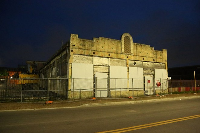 The Whitt building as it stands facing West Houston Street on the night of May 30. - SA HERON / BEN OLIVO