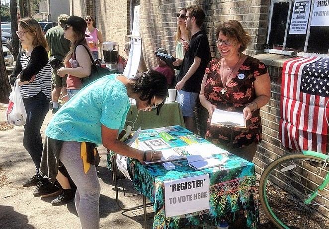 Organizers operate a recent voter registration drive. - WIKIMEDIA COMMONS / BART EVERSON