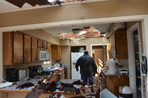 Adrian Venegas stands in what's left of his kitchen. - ALEX ZIELINSKI