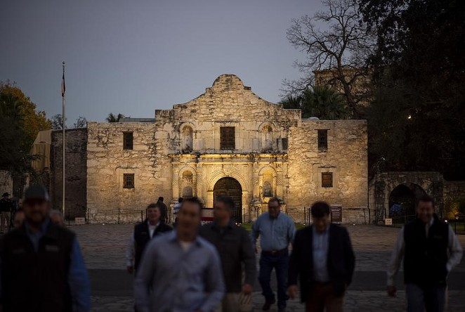 Visitors cross the street away from the Alamo in San Antonio. - TEXAS TRIBUNE / EDDIE GASPAR