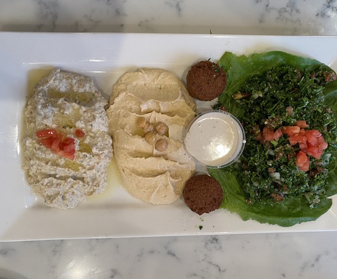 Zaatar's hummus is classically creamy and presented simply, although a spicy version is also available. - RON BECHTOL
