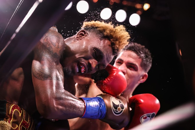 Castaño connects a forceful punch during Saturday's fight. - AMANDA WESTCOTT / SHOWTIME