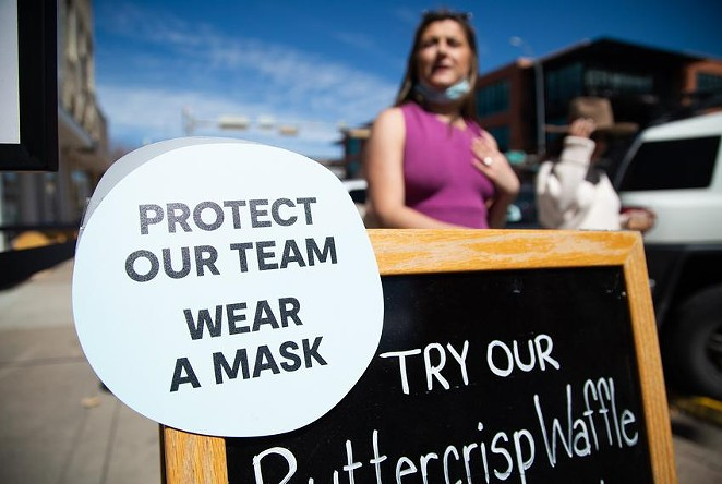 A sign in South Austin asks customers to wear a mask inside a business on March 3, 2021. - TEXAS TRIBUNE / EVAN L'ROY