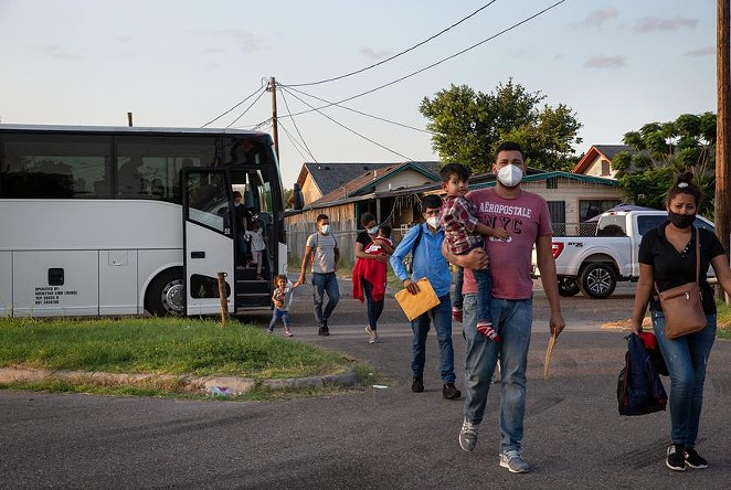 A group of migrants are dropped off at Our Lady of Guadalupe Catholic Church in Mission on Wednesday. - TEXAS TRIBUNE / JASON GARZA