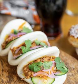 Chef Phil Carden's achiote-braised pork belly steamed buns. - INSTAGRAM / THEDOORYARDSA