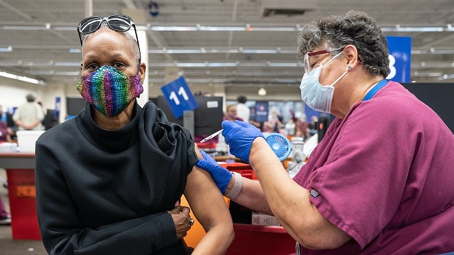 A San Antonio resident gets her jab at a mass vaccination site earlier this year. - UNIVERSITY HEALTH