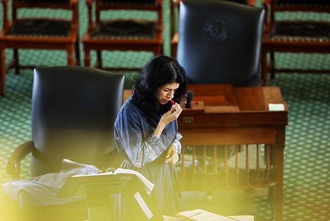State Sen. Carol Alvarado, D-Houston, applies lipstick in her 15th hour of filibustering against Senate Bill 1. - TEXAS TRIBUNE / MIGUEL GUTIERREZ JR.