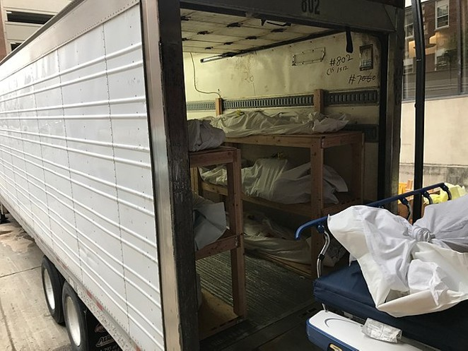 Bodies of COVID-19 fatalities are loaded into a mortuary trailer in New Jersey during April of last year. - WIKIMEDIA COMMONS /CREATIVE COMMONS ZERO, PUBLIC DOMAIN DEDICATION
