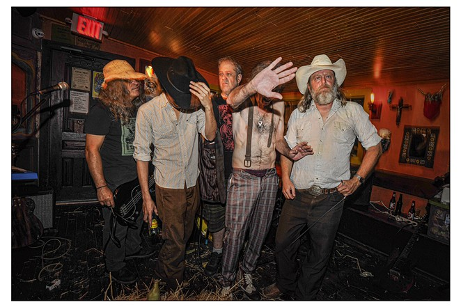 Hickoid Jeff Smith (second from right) hides his face as the band pauses for photo following a gig. - COURTESY PHOTO / RICHARD TOMCALA