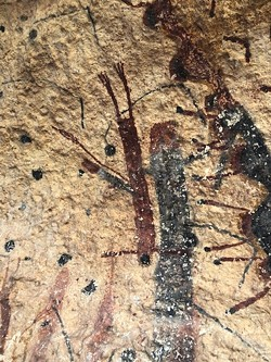 A closeup of the multicolored images at the White Shaman site. - BILL BAIRD