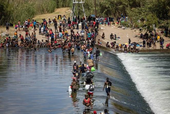 Migrants cross the Rio Grande between the United States and Mexico in Ciudad Acuña, across the border from Del Rio. - TEXAS TRIBUNE / JORDAN VONDERHAAR