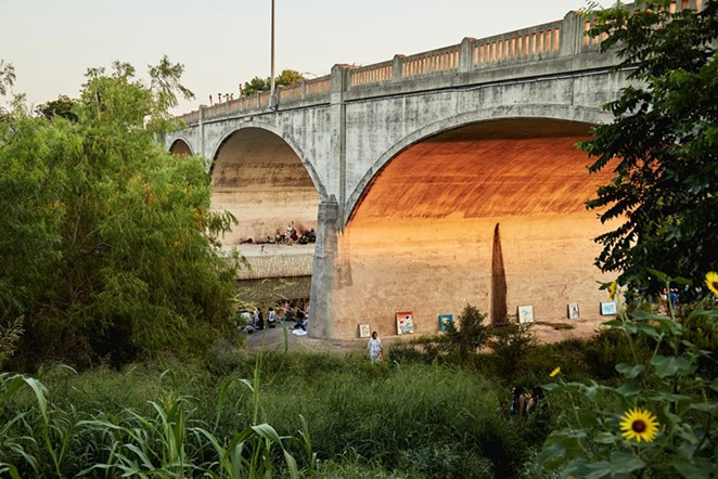 People gather under the Roosevelt Avenue Bridge on June 21 for a concert organized by the Echo Bridge Appreciation Society. - SA HERON / TYLER SMITH