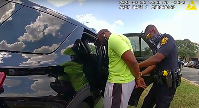 Body cam footage shows officers detaining jogger Mathias Ometu in August 2020. - YOUTUBE / SAN ANTONIO POLICE DEPARTMENT