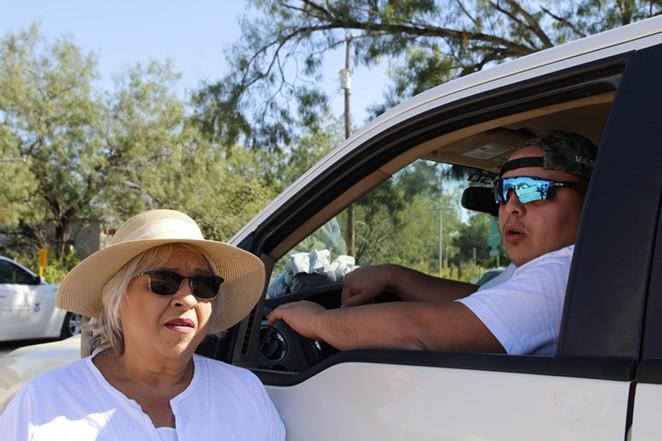 Pamela Rivas and her son Ivan commiserate over Border Patrol surveillance. - GUS BOVA