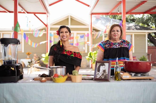 """San Antonio professor Keli Rosa Cabunoc Romero (left) and  Malena Gonzalez-Cid on the set of """"The Día de los Muertos Menu."""" - PHOTO COURTESY FOOD NETWORK"""