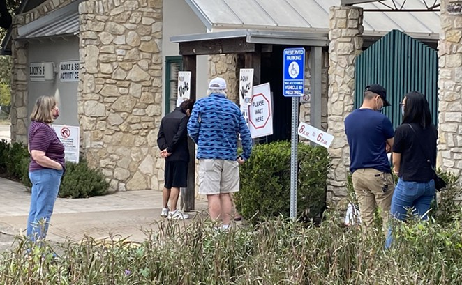 Voters wait in line to vote at Lion's Field in San Antonio. - SANFORD NOWLIN