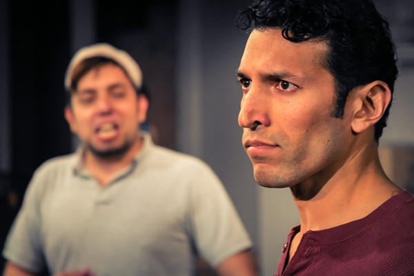 Luis Legaspi (as Abe) and Suhail Arastu (as Amir) in The Playhouse's production of Disgraced - PHOTO BY DANIEL BAUMER