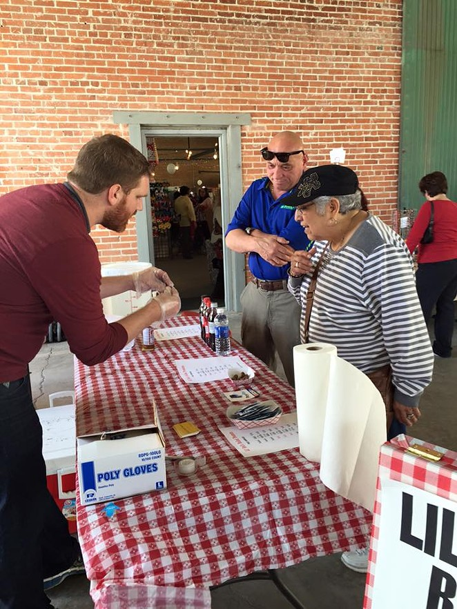 McAndrews explaining how to eat boiled peanuts at the South Flores Market in 2016 -  FACEBOOK/LIL' RED'S BOILED PEANUTS
