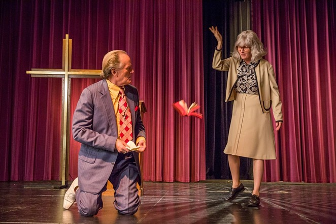 Madalyn Murray O'Hair (Melissa Leo) debates Reverend Harrington (Peter Fonda) on religion in The Most Hated Woman in America. - NETFLIX