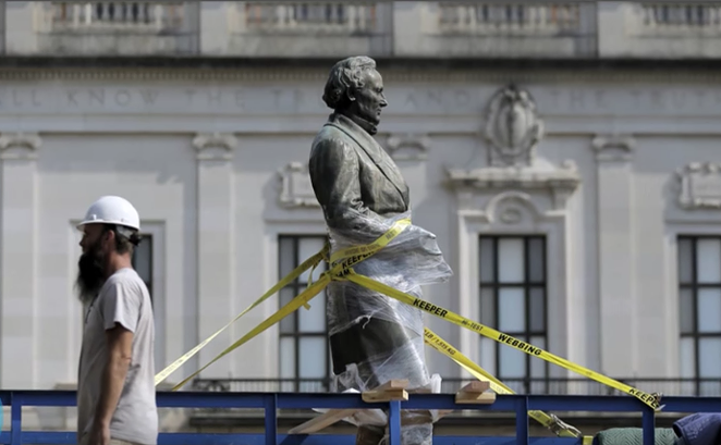 A Jefferson Davis statue being removed from UT Austin campus in 2015. - YOUTUBE.COM VIA WOTCHIT NEWS