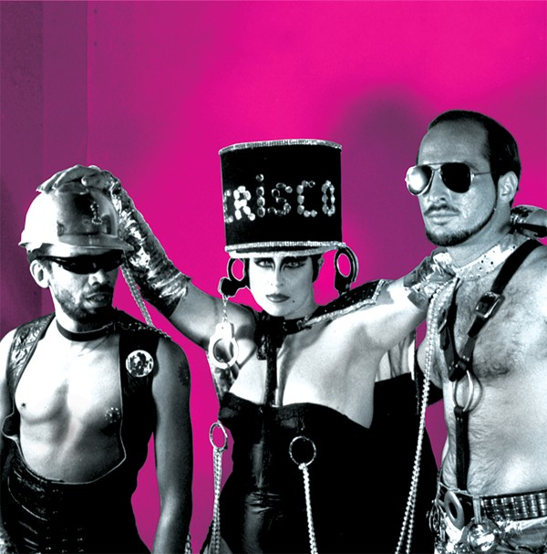 H.M. Jeanie Pancakes as Queen of the Leather Scene, accompanied by Sterling Houston and John Dimler, 1982 (courtesy of the Institute of Texan Cultures)
