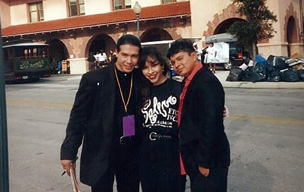 SA native Lupe Moreno with actors Jon Seda (left) and Jacob Vargas (right) at Sunset Station during shooting for the 1997 biopic Selena. Moreno, who auditioned for the title role, was instead hired as a stand-in and photo double for Jennifer Lopez. - LUPE MORENO