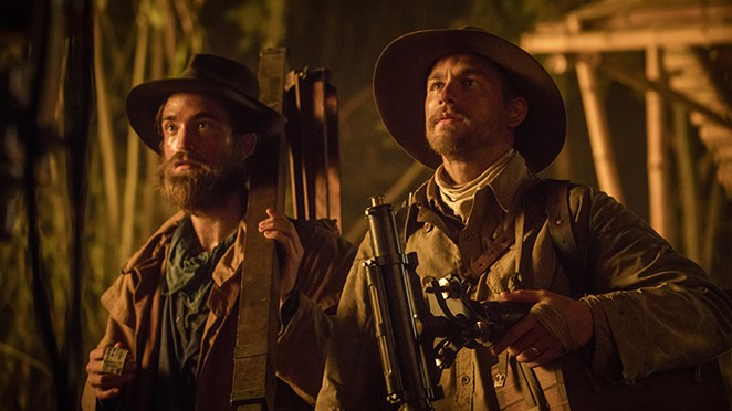 Robert Pattinson (as Henry Costin) and Charlie Hunnam (as  Percy Fawcett) in The Lost City of Z - AMAZON STUDIOS / BLEECKER STREET