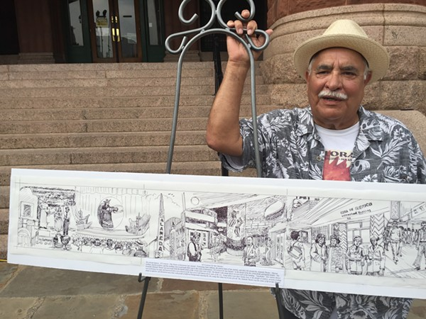 "Joe Lopez stands beside his rendering of San Antonio's ""the good old times."" - MONICA SIMMONS"